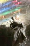 Virgin mary sculpture holding baby jesus rainbow lighting inspirational holy royalty free stock photos