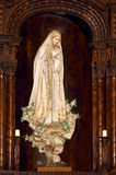 Virgin Mary. Sculpture image surrounded by a beautiful carved wood arch Stock Images