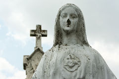 Virgin Mary Statue and Cross Cemetery Royalty Free Stock Photography