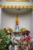 Virgin mary statue with flowers in Thailand royalty free stock images