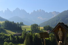 Virgin Mary statue in front of Dolomites Group, Val di Funes, Royalty Free Stock Photo