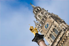 Virgin mary statue in munich. Virgin mary statue in front of the munich town hall, germany Stock Images