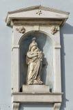Virgin Mary statue on  stone wall in Piran, Slovenia Stock Photo