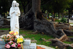 Virgin Mother and Baby. A Statue of the Virgin Mother is adorned with flowers at the Cuban Memorial, Miami Stock Photography