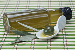 Virgin olive oil on a bamboo mat Royalty Free Stock Image