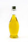 Virgin olive oil in a crystal bottle isolated stock photo