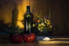 virgin olive oil flour rosemary  and tomatoes Royalty Free Stock Photos