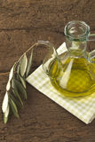 Virgin olive oil in glass jar Stock Photo