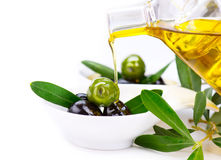 Virgin olive oil pouring Royalty Free Stock Images