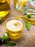 Virgin olive oil pouring in a bowl closeup Royalty Free Stock Image