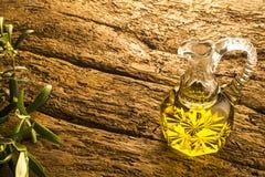 Virgin olive oil in vintage glass oil jar Royalty Free Stock Photos