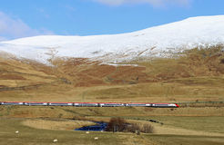 Pendolino electric train in winter countryside Stock Images