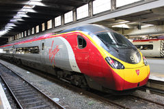 Virgin pendolino electric train at London Euston. Front of electric multiple unit train number 390154 in Virgin livery at a platform at the end of a journey on Stock Images