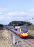 Virgin pendolino train on West Coast mainline. Stock Image
