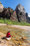 Virgin River in Zion National Park, Utah. Teenage girl at river's edge in main valley at Zion Stock Photos
