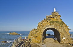 Virgin on the Rock of Biarritz. Monument of Virgin on the Rock, an emblematic place and the natural curiosity in Biarritz city, built in natural rock, Ocean and Royalty Free Stock Image