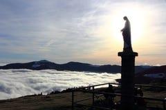 Virgin of the Small Balloon in Alsace. Statue of the Virgin above the fog in Alsace Royalty Free Stock Photos