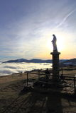 Virgin of the Small Balloon in Alsace. Statue of the Virgin above the fog in Alsace Stock Images