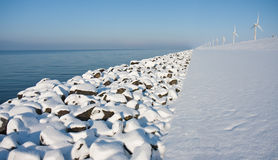 Virgin snow along the endless Dutch coast. Virgin snow along the endless coast in the netherlands royalty free stock image