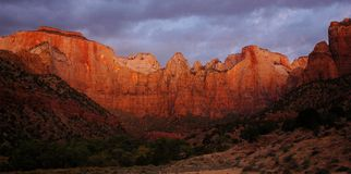 Virgin Towers Dawn, Zion. Captured at dawn in Zion National Park, The Virgin Towers are lit up in vivid red, pink and yellow hues Stock Photography
