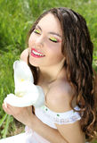 Virgin young woman with white flowers. Beautiful portrait of a tender woman on the nature. Wedding Royalty Free Stock Images
