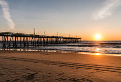 Virginia Beach Boardwalk Fishing Pier at Dawn. Virginia Beach, Virginia boardwalk fishing pier and beach at dawn Royalty Free Stock Photos