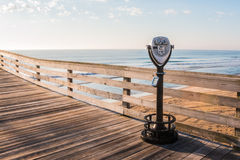 Virginia Beach Coin-operated sightseeing binoculars. Coin-operated sightseeing binoculars on the Virginia Beach fishing pier Stock Photo