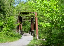 Virginia Creeper Trail. One of the many trestles crossed while traveling on the Virginia Creeper Trail, one of the most popular rail-trails in the United States stock photography