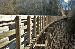 Virginia Creeper Trail. One of the wooden trestles crossing Whitetop Laurel Creek along the Virginia Creeper Trail VCT. The VCT, a 34 mile rail trail running royalty free stock image