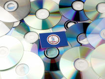 Virginia flag on top of CD and DVD pile isolated on white Stock Photography