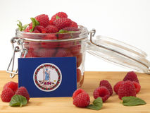 Virginia flag on a wooden panel with raspberries isolated on a w stock image