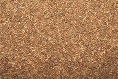Virginia Gold Smoking Tobacco Close-Up-Achtergrondafbeelding stock afbeeldingen