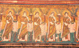 Virgins with gifts. Ancient roman mosaic of a procession of virgins bearing gifts and wearing phrygian caps Royalty Free Stock Photos