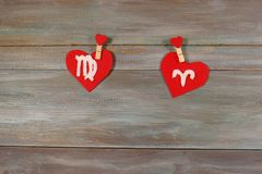 Virgo and the Aries. signs of the zodiac and heart. wooden backg. Round. card. astronomy. Love. unusual handwork royalty free stock photography