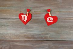 Virgo and cancer. signs of the zodiac and heart. wooden backgrou. Nd. card. Love. unusual handwork royalty free stock images