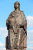 Virgo Marie with infant. Monument on background blue sky Royalty Free Stock Photo