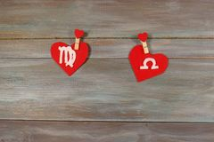 Virgo and scales. signs of the zodiac and heart. wooden backgrou. Nd. card. Love. unusual handwork royalty free stock photography