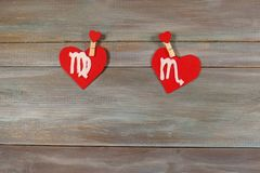 Virgo and scorpion. signs of the zodiac and heart. wooden backgr. Ound. card. Love. unusual handwork stock photos