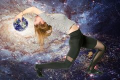Virgo zodiac girl. Young athletic thin virgo zodiac girl curved back with the planet Earth ball on the galaxy background. elements of image furnished by NASA stock images