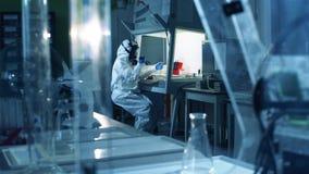 Virologist in hazmat works in laboratory while creating vaccine. Coronavirus, COVID-19, 2019-ncov medicines research