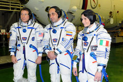Virts, Shkaplerov and Cristoforetti in Inegration Facility Build. ISS Expedition 42/43 crewmembers T.Virts (left), A.Shkaplerov (center), S.Cristoforetti (right Stock Images