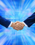 Virtual Business Handshake. Two businessmen shaking hands with a futuristic virtual background Stock Image