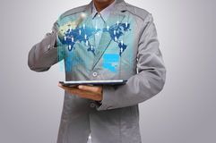 Virtual business network process diagram. Business man hand point to virtual business network process diagram, with on a tablet pc Stock Photo