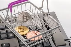 Virtual coins bitcoin in shopping cart on advance keyboard, trad Royalty Free Stock Photo