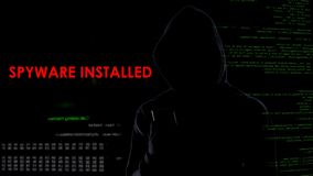 Virtual criminal installed spyware in smartphone, illegal attack on privacy. Stock photo stock photography
