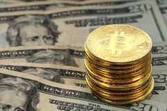 Bitcoin coins on United States US twenty dollar bill $20. Virtual cryptocurrency money Bitcoin golden coins on United States US twenty dollar bill $20 with the royalty free stock image