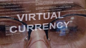 Virtual currency text on background of female developer. Virtual currency text on the background of female software developer. Eyes of woman with glasses are stock footage