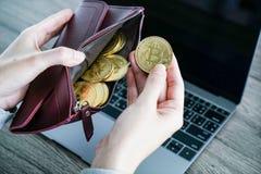 Virtual currency wallet gold bitcoin. bitcoin laptop wallet. Bit Stock Photo
