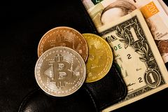Virtual currency wallet. Bitcoin gold coin and money. Cryptocurrency concept Stock Photo