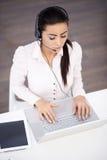 Virtual Customer Service Using Laptop on Table Royalty Free Stock Photo